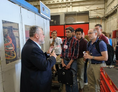 Ernie Fretter, the Arc Jet's business manager, welcomed a group from the 10th International Planetary Probe Workshop and guided them through the facility. Image credit: NASA Ames / Dominic Hart