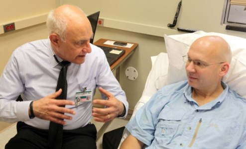 William Russell, M.D., left, talks with participant Ric Hudgens at the Vanderbilt Eskind Diabetes Clinic about a new study examining the ability of the drug abatacept to prevent type 1 diabetes.