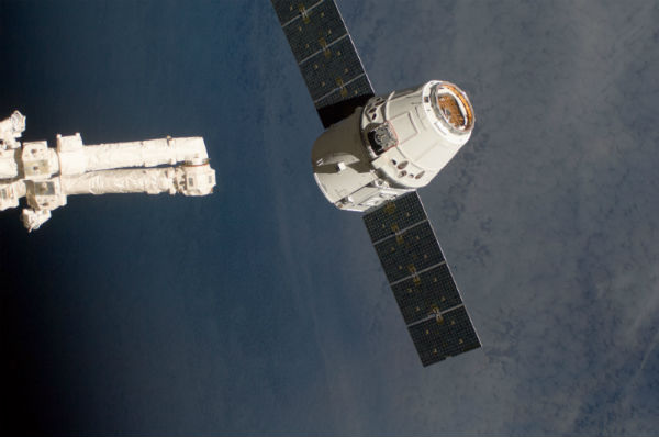 The SpaceX Dragon commercial cargo craft, as it is about to be grappled by the Canadarm2 robotic arm at the International Space Station in May 2012.
