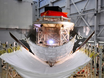 The three panel or fairings encapsulating a stand-in for Orion's service module successfully detach during a test Nov. 6, 2013 at Lockheed Martin's facility in Sunnyvale, Calif.
